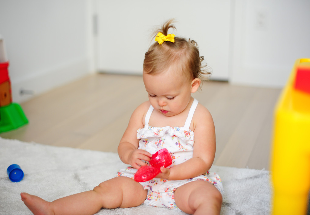 Baby Gluck playing with Old Navy Mary Jane Jelly Sandals for Baby
