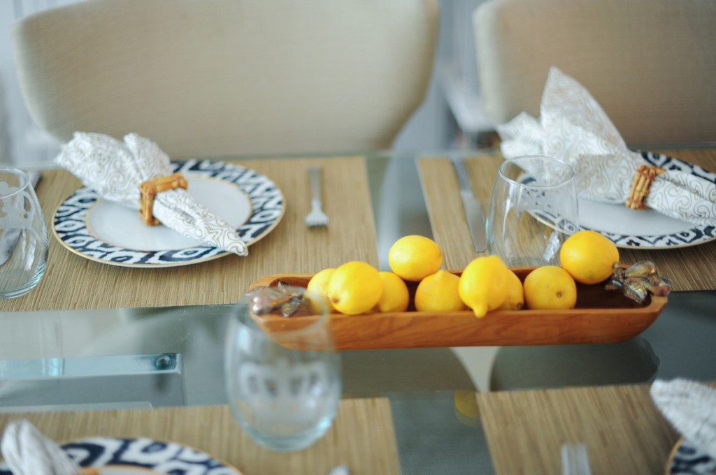 Host a simple summer dinner with lemon centerpiece // FashionableHostess.com
