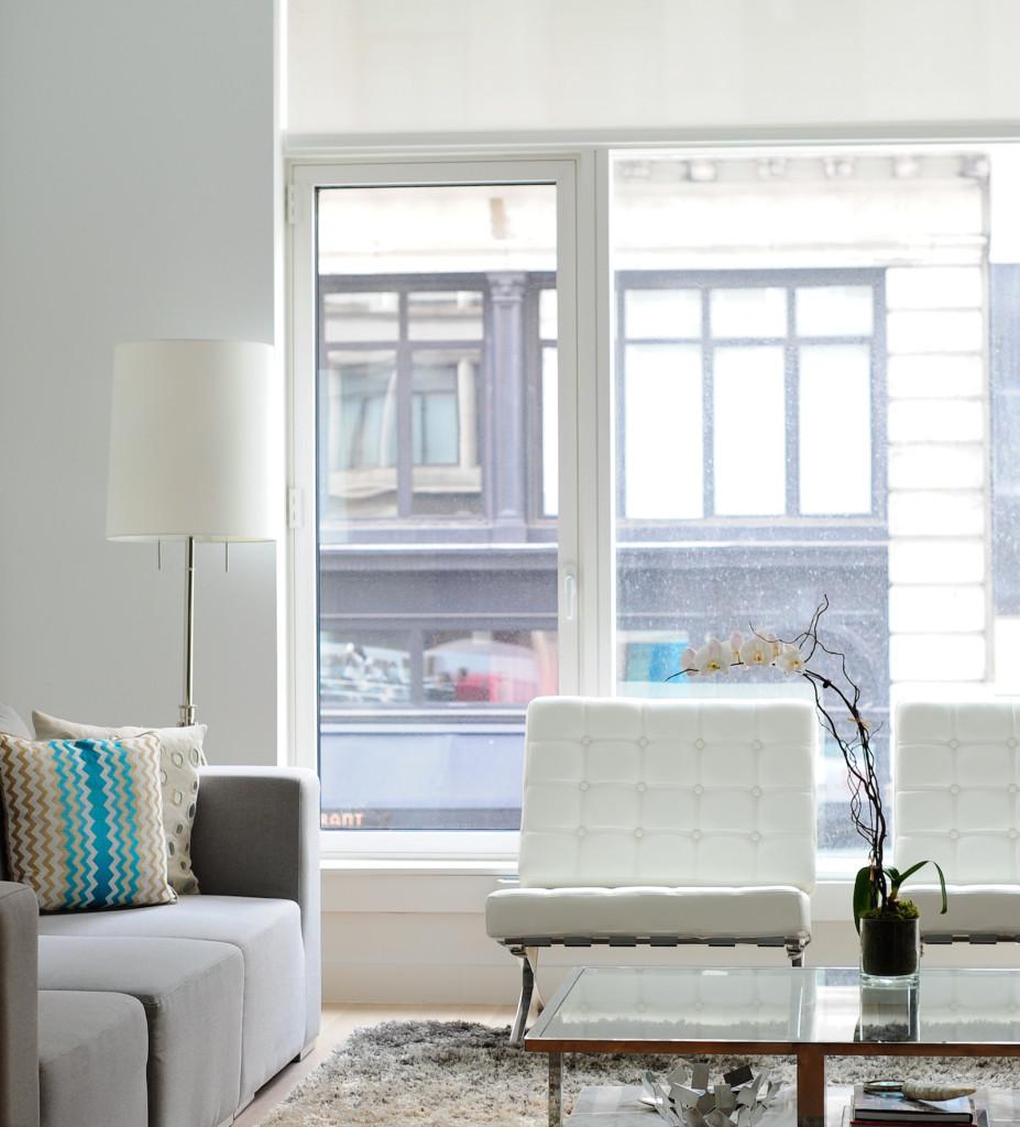 White & Sleek Living Room with Barcelona Chair