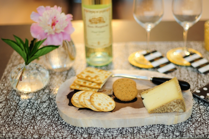host a wine and cheese night for friends