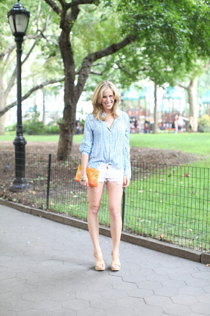 Fashionable Hostess - wearing white rag n bone ripped denim shorts, Bella Dahl shirt, nursign top, sequin prada clutch, elaine turner katrina cork strappy wedge sandal, yellow gold cartier love bracelet, julie vos gold cuff in Madison Square Park