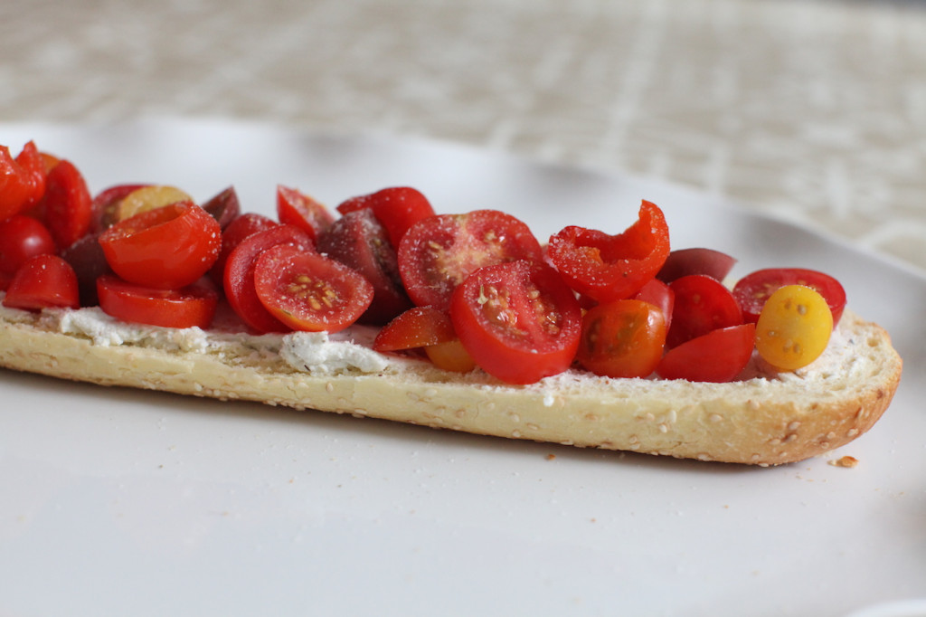Goat cheese crostini with cherry tomatoes, goat cheese and marinated hot peppers
