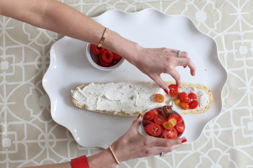 Crostini appetizer using goat cheese, cherry tomatoes and marinate hot peppers are a perfect end of summer idea