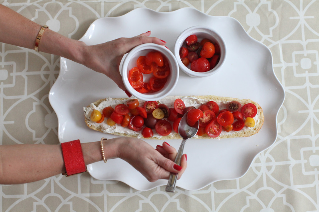 Arrange the hot peppers on the goat cheese crostini. Quality tomatoes are the best for this dish.