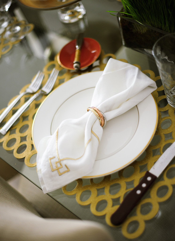 At each place setting I put a Chilewich Mod Placemat, Kim Seybert Napkin, and L'Objet Napkin Ring