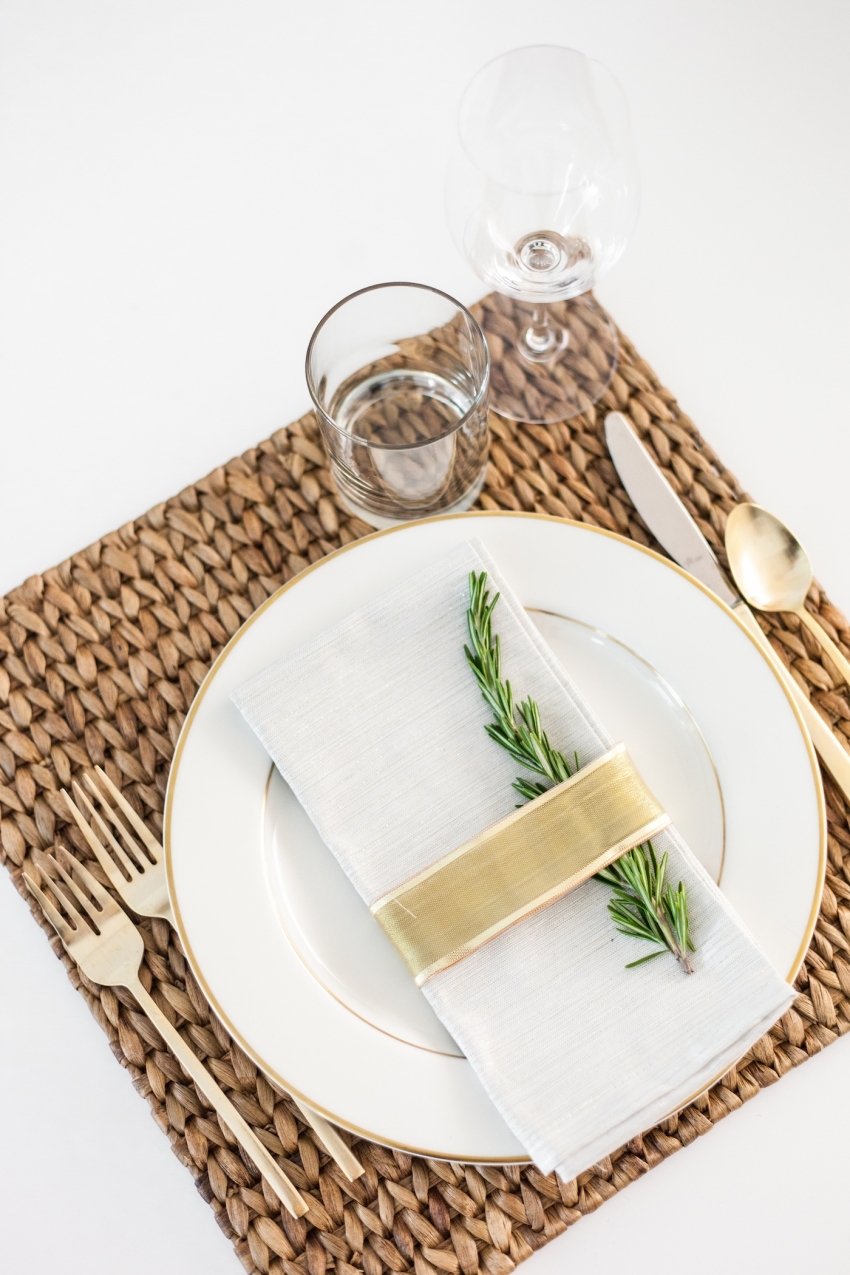 DIY Place card settings for the Holidays using Rosemary and gold ribbon + gold silverware