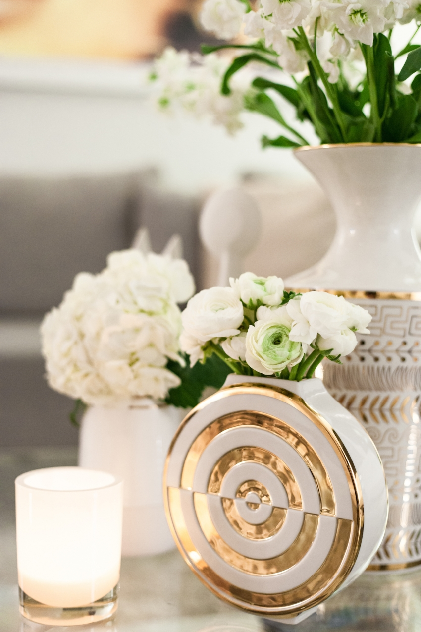Jonathan adler round vase in white and gold with white ranunculus