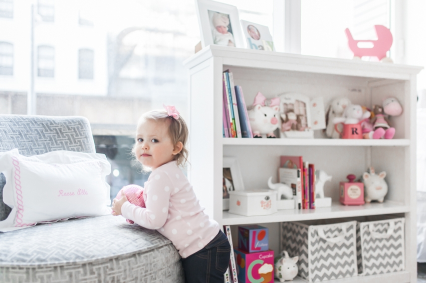 Reese Gluck and Her nursery shelves