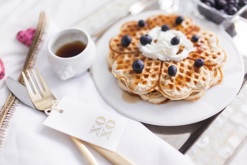 Valentine's Day Breakfast in bed with heart waffles with blueberries by Fashionable Hostess