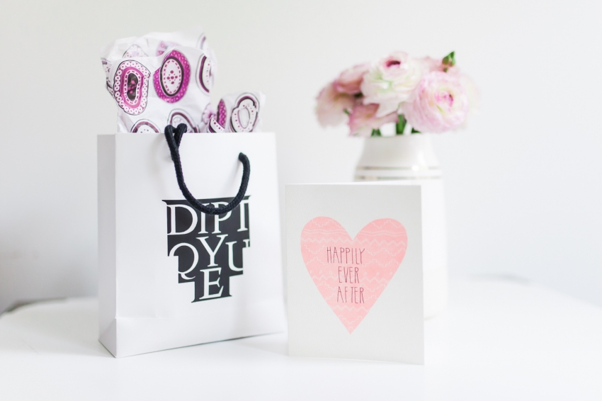 Valentine's Day presents for Her - Diptyque Candle and ranunculus