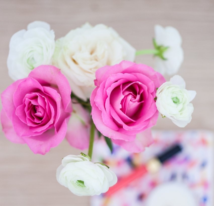pink roses and white ranunculus arrangements