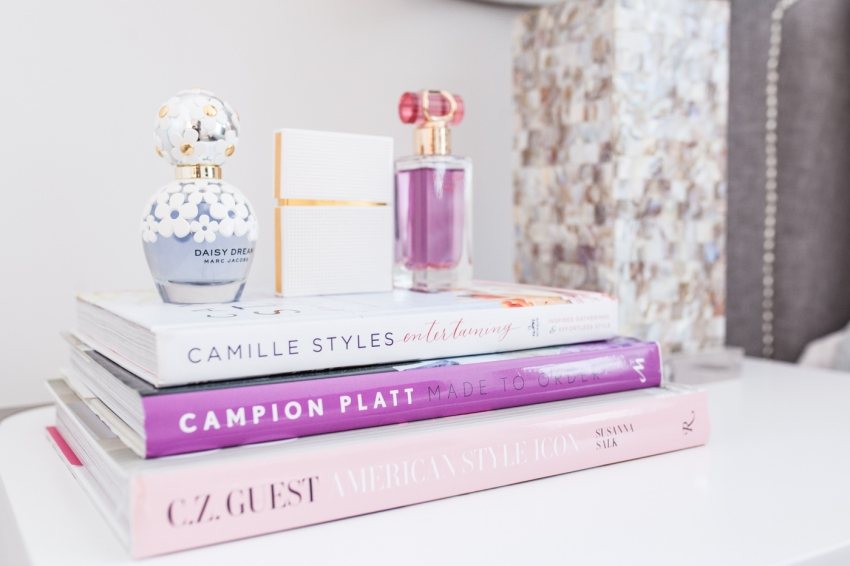 Fashionable Hostess Bedside Table - stacked coffee table books and perfumes 2