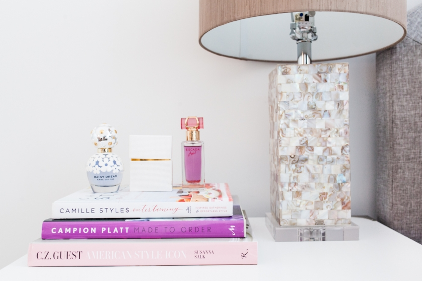 Fashionable Hostess Bedside Table - stacked coffee table books and perfumes