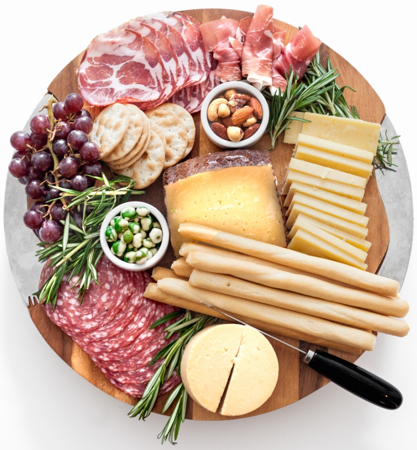 Create a gorgeous cheese platter for summer entertaining with salami, breadsticks, assorted cheeses