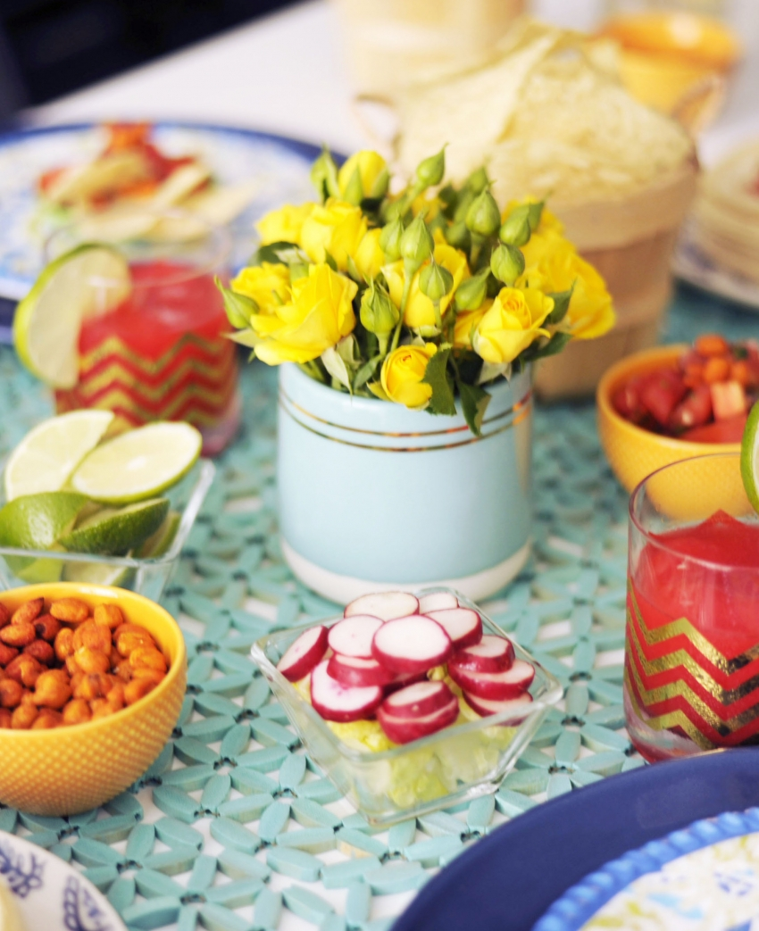 Setting the table for your Cinco de Mayo Party at home with margaritas and tacos copy