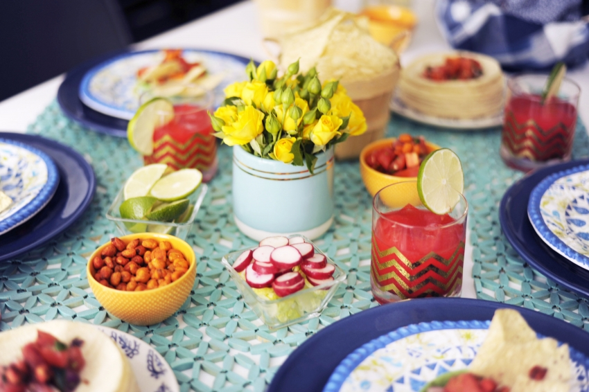 Setting the table for your Cinco de Mayo Party at home with margaritas and tacos