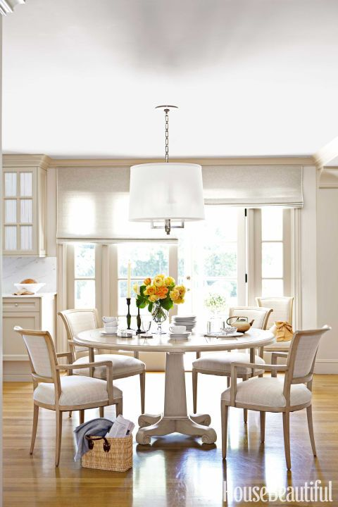 Round Breakfast Table with Classic Arm Chairs by House Beautiful