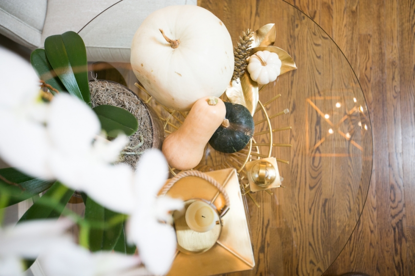 Foyer table with gorgeous Fall Decor with Lantern, Pumpkins, Orchids, Gourds, and Pinecones on Fashionable Hostess