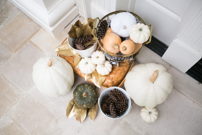 Gold Leaves, Pinecones, and Pumpkins on Entry of beautiful home on Fashionable Hostess