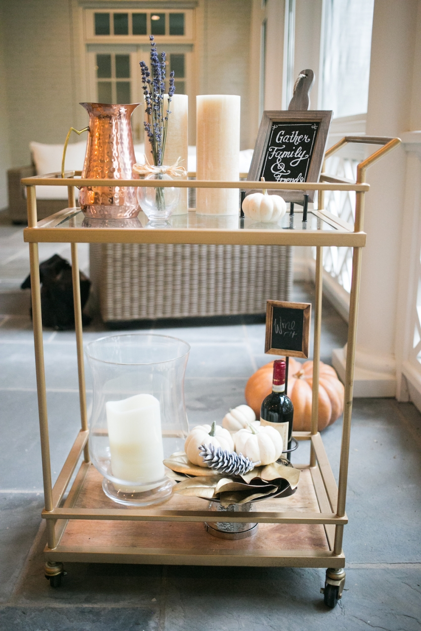 Gorgeous Patio with Fall Bar Cart with Pumpkins and Copper on Fashionable Hostess