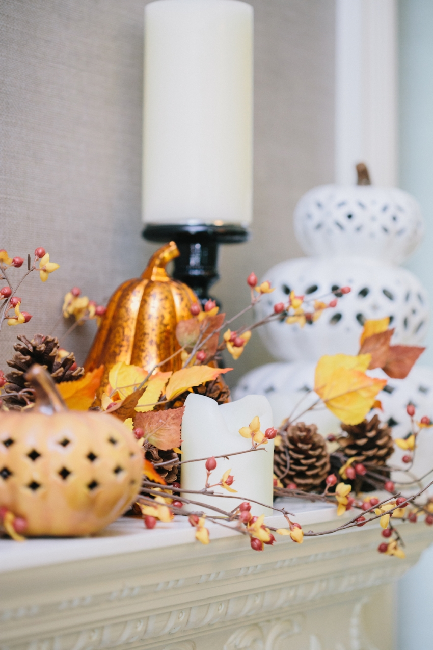 Autumn Fireplace Mantel Glitter and Ceramic Filigree Punched Pumpkins with Autumn Berry Garland Surrounded with Pinecones and Pottery Barn Glass Pillar Candleholder on Fashionable Hostess