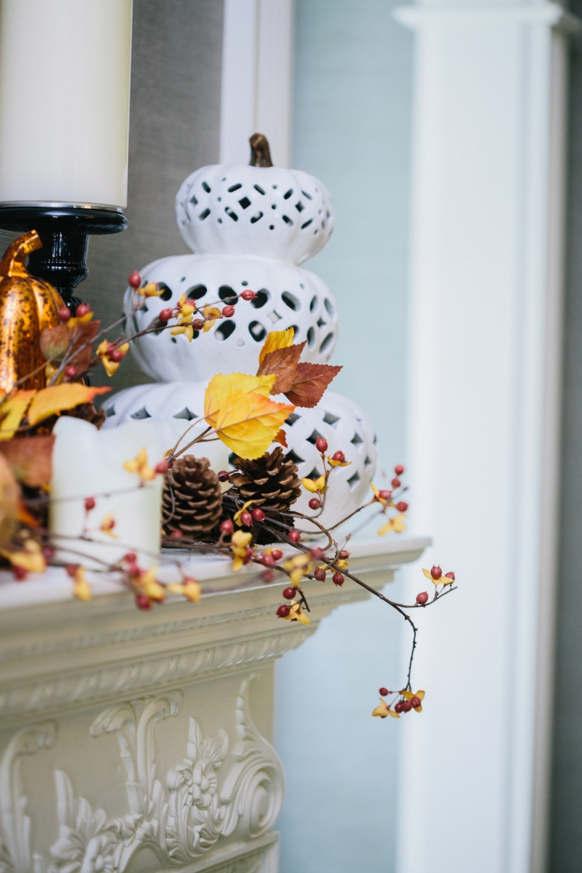 Filigree Punched Ceramic and Glittery Pumpkins on Fireplace Mantel in Classic Southern Home on a Autumn Berry Garland on Fashionable Hostess