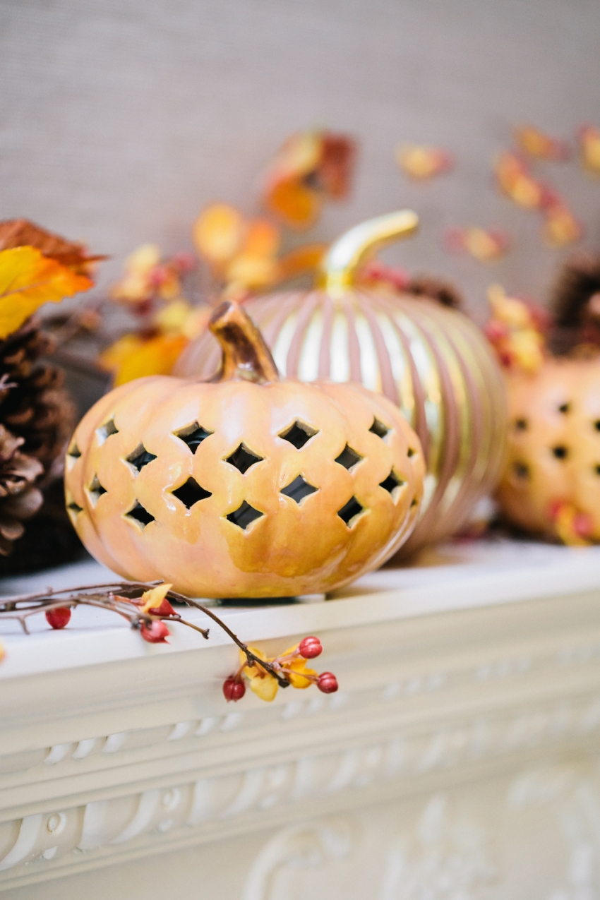 Filigree Punched Ceramin Pumpkins, Grout and Mercury Pumpkins-Rust, and Autumn Berry Garland on Autumn White Mantel from Pottery Barn on Fashionable Hostess