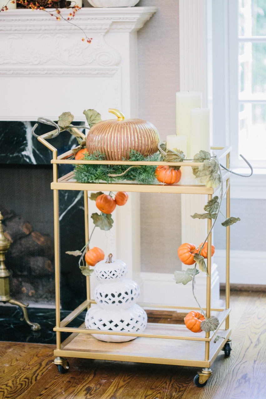 Bar Cart from Target with Pumpkin Autumn Garland and Filigree and Grout:Mercury Pumpkin from Pottery Barn in front of a Classic White and Marble Fireplace Mantel on Fashionable Hostess2