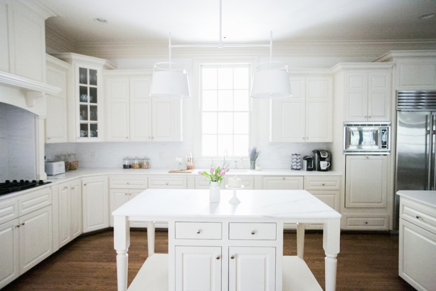 Gorgeous White Kitchen Inpiration with White Marble Island and Urban Electric Light Fixture Natural Light on Fashionable Hostess