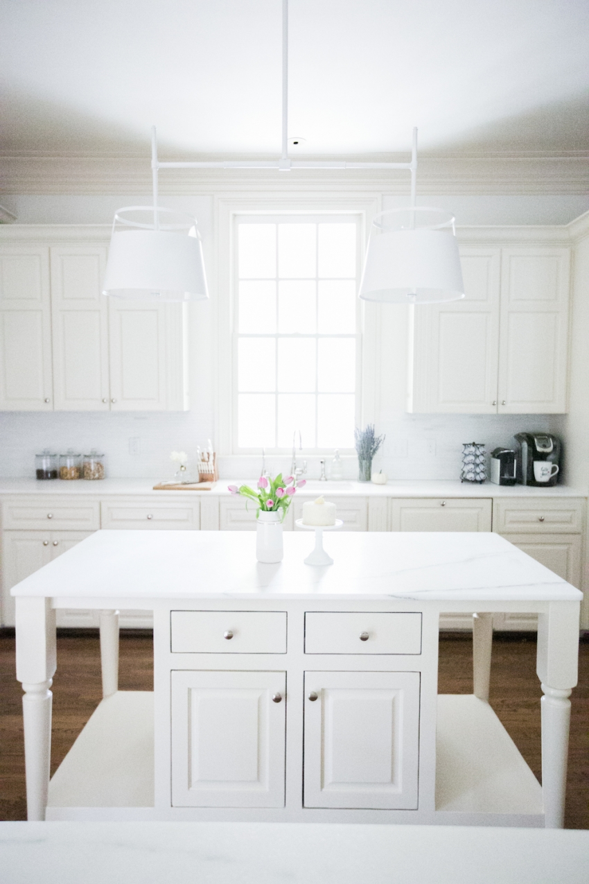 Gorgeous White Marble Island with Light Fixture by Urban Electric Above Amazing Light from Window above Farm Sink on Fashionable Hostess