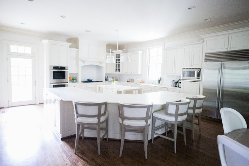 White Kitchen Design Inspiration Marble Countertops and Island with White Cabinetry on Fashionable Hostess
