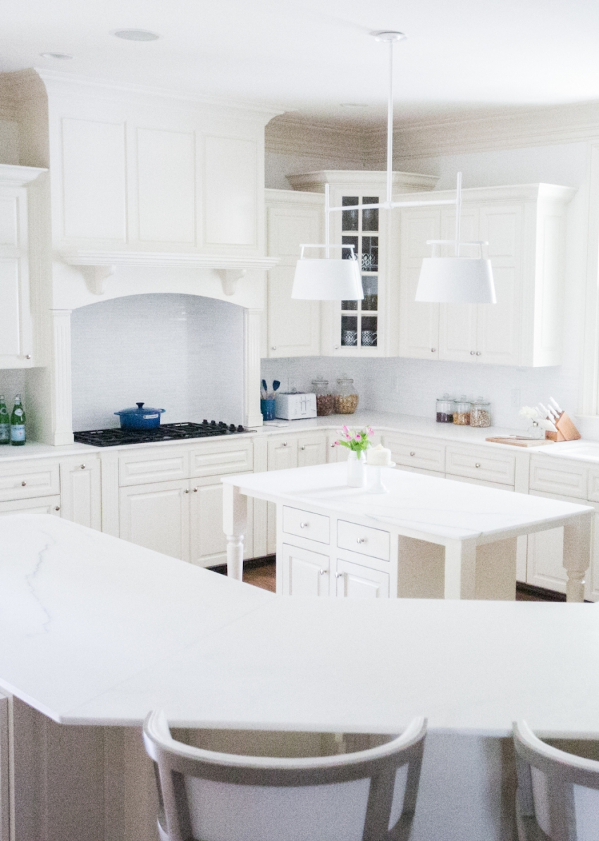 White Kitchen Inspiration with Urban Electric Light Fixture and White Cabinets and Marble Countertops on Fashionable Hostess