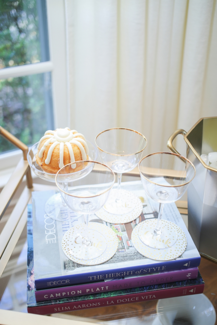 Thanksgiving cocktails in gold rimmed wine glasses by Fashionable Hostess